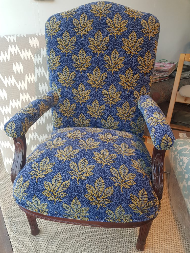 Armchair upholstered in blue and gold fabric